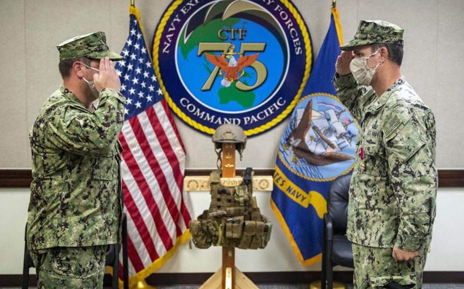 Capt. Gareth Healy, left, took command of Task Force 75 from Capt. Eric Correll, right, on Friday during a ceremony at Naval Base Guam, Friday, Oct. 2, 2020.
