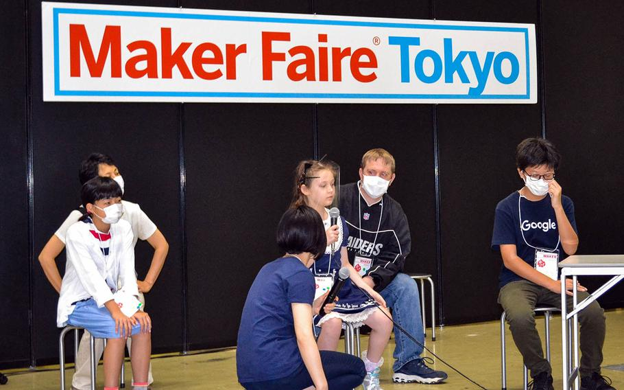 Alice Stratton, a fourth-grader at Daihachi Elementary School near Yokota Air Base, Japan, tells the judges about her invention, an LED game clock, during Maker Faire 2020 in Tokyo, Saturday, Oct. 3, 2020.