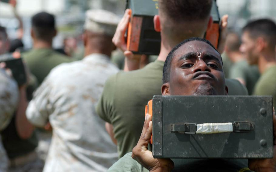 Marines lift ammunition canisters during a combat fitness test in 2008 at Camp Foster, Okinawa.
