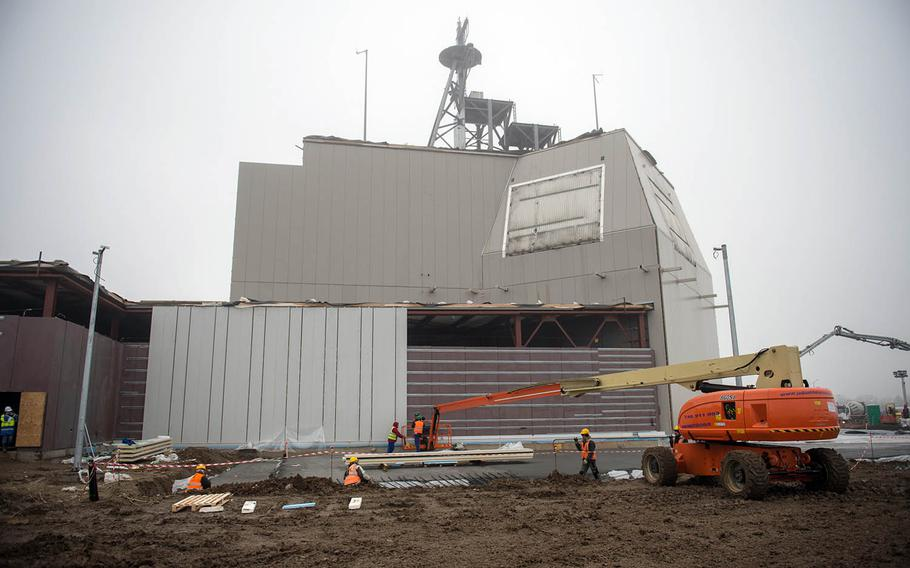 Sailors, along with American and Romanian contractors, construct an Aegis Ashore Missile Defense System at Naval Support Faculty Deveselu, Romania, Jan. 21, 2015.