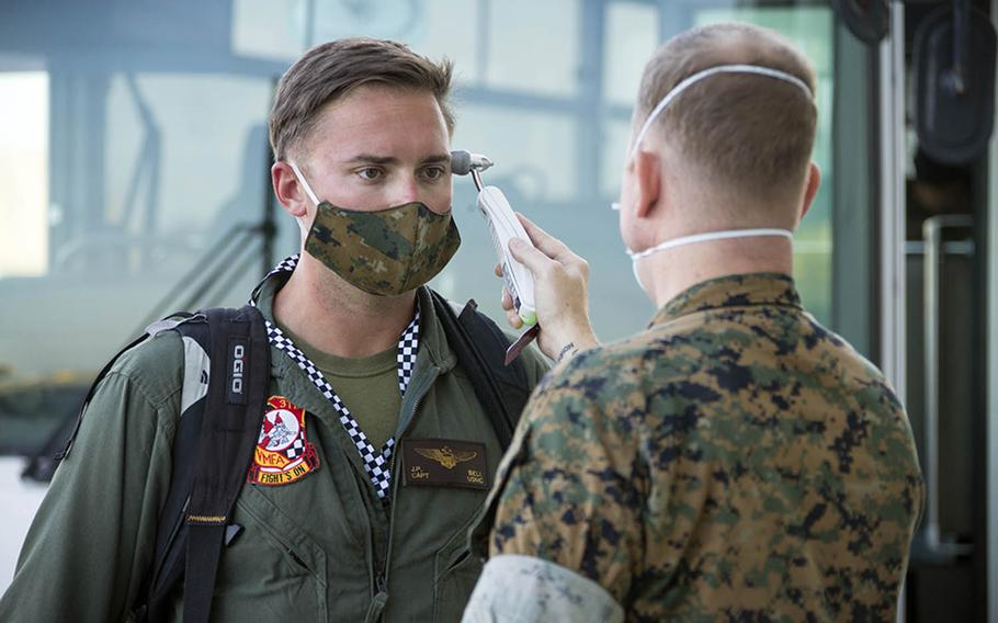 Capt. John Bell, a pilot with Marine Fighter Attack Squadron 312, is screened for coronavirus symptoms after arriving at Marine Corps Air Station Iwakuni, Japan, Oct. 2, 2020.