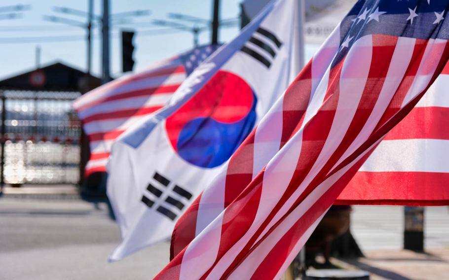 American and South Korea flags wave outside Camp Humphreys, South Korea, March 16, 2020.