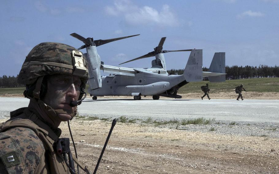 Forward air-controller Capt. David Kee stands by as Marines pour out of an MV-22 Osprey to seize the airfield at Ie Shima, Okinawa, Wednesday, Oct. 7, 2020, during the Noble Fury exercise.