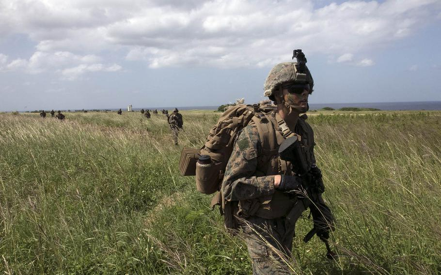 Marines patrol Ie Shima, Okinawa, after securing the Japanese island's airfield during Noble Fury drills, Wednesday, Oct. 7, 2020.