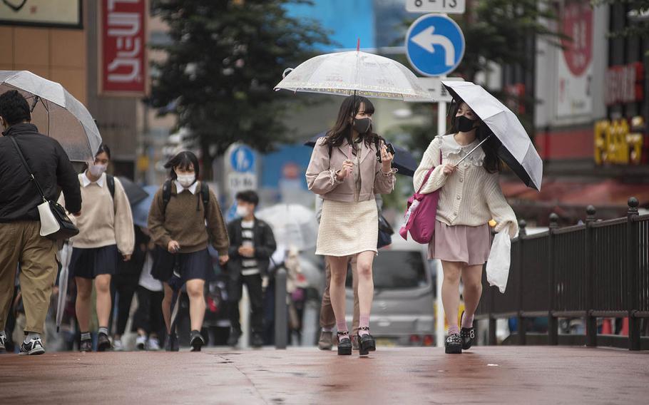 People wear face masks to guard against the coronavirus near Yokohama Station in Yokohama, Japan, Oct. 8, 2020.