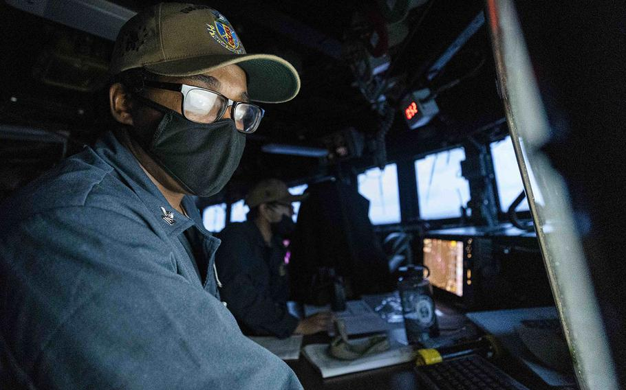 Petty Officer 2nd Class Noble Myrick, of Butler, Pa., stands watch in the pilot house of the guided-missile destroyer USS John S. McCain in the South China Sea, Oct. 12, 2020.
