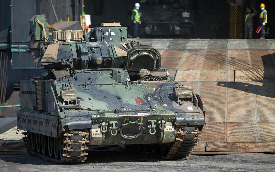 Tracked armored vehicles from the Fort Stewart, Ga.-based 1st Armored Brigade Combat Team, 3rd Infantry Division arrive at Busan, South Korea, Thursday, Oct. 15, 2020.