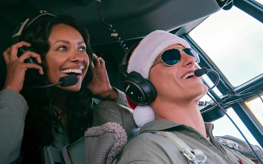 """A congressional aide who meets her match in an Air Force captain in the upcoming Netflix holiday romance """"Operation Christmas Drop."""""""