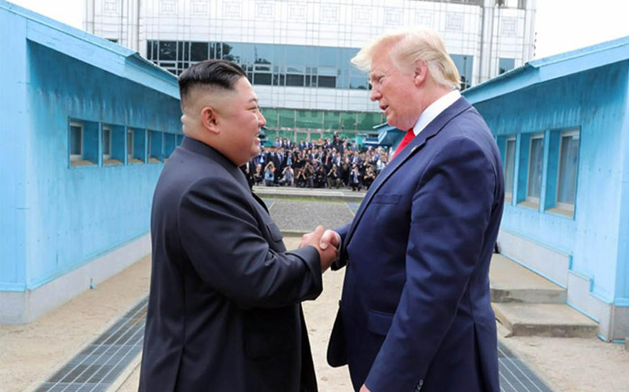 President Donald Trump speaks with North Korean leader Kim Jong Un on the North Korean side of the Joint Security Area, June 30, 2019.
