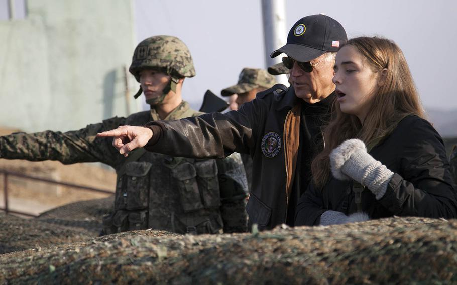 Then-Vice President Joe Biden points out an area of North Korea to his granddaughter, Finnegan Biden, during a visit to the Demilitarized Zone on Dec.7, 2013.