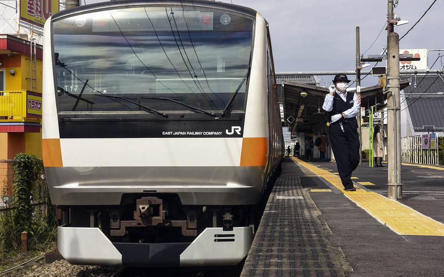 An Ome line train prepares to depart Ushihama Station, near Yokota Air Base, Japan, Thursday, Oct. 22, 2020.