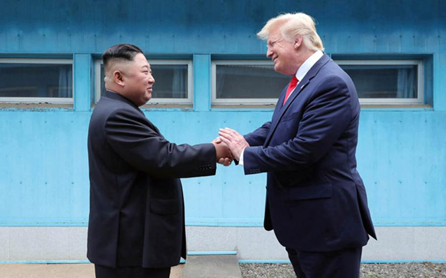 North Korean leader Kim Jong Un and President Donald Trump shake hands across the line separating North and South Korea on June 30, 2019.