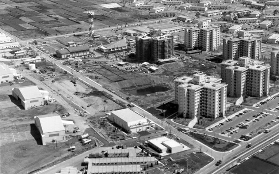 This aerial view of Yokota Air Base, Japan, shows housing towers and other buildings under construction on the east side in the mid-1970s.