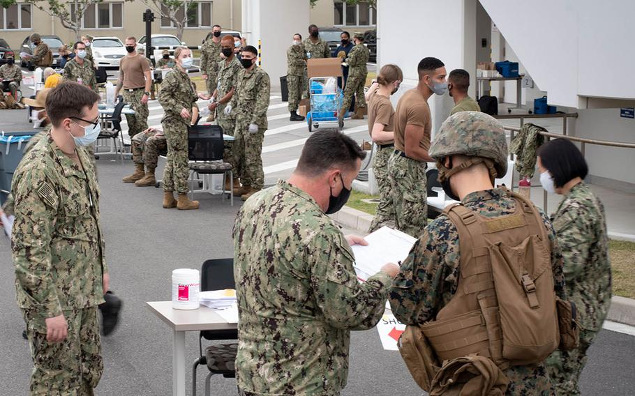 Sailors from the Branch Health Clinic at Marine Corps Air Station Iwakuni, Japan, innoculate active-duty troops with the flu vaccine to simulate a pandemic response during exercise Active Shield, Oct. 28, 2020.
