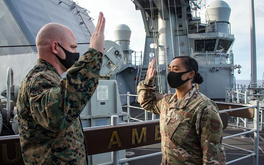 First Lt. Rio Sarmiento, right, is sworn into the Space Force during a two-month patrol aboard the USS America, Sept. 17, 2020.