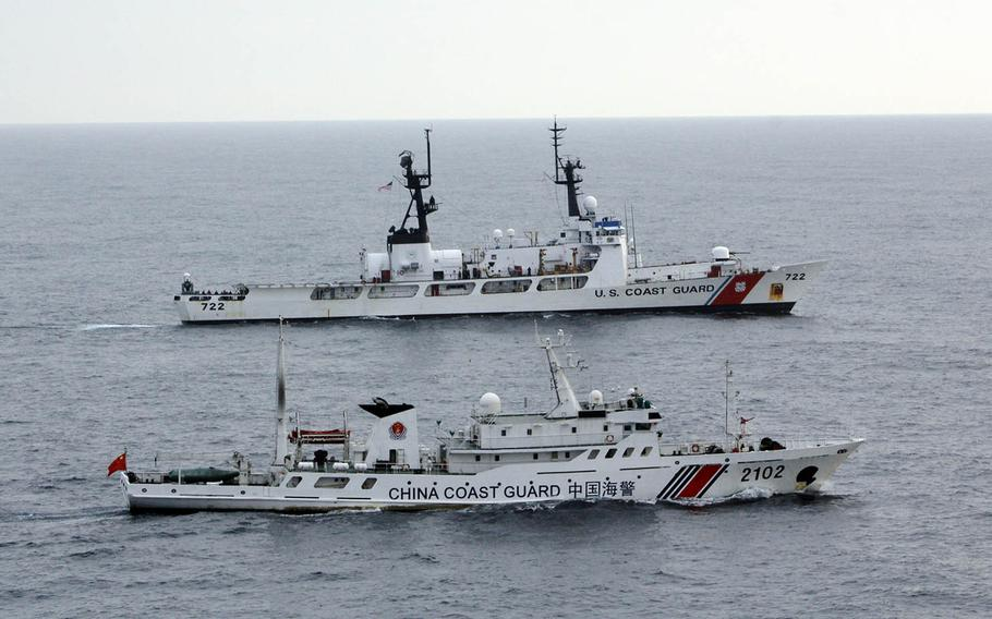 Vessels from the U.S. and Chinese coast guards sail alongside each other somewhere in the northern Pacific Ocean in 2014.