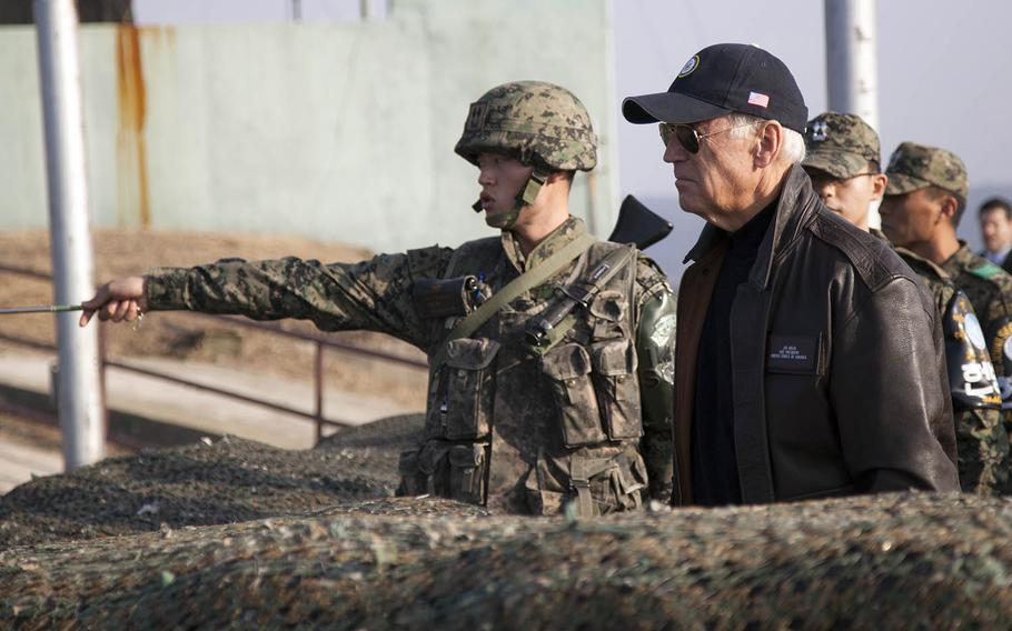 Then-Vice President Joe Biden looks out at North Korea from Observation Point Ouellette in the Demilitarized Zone, Dec. 7, 2013.