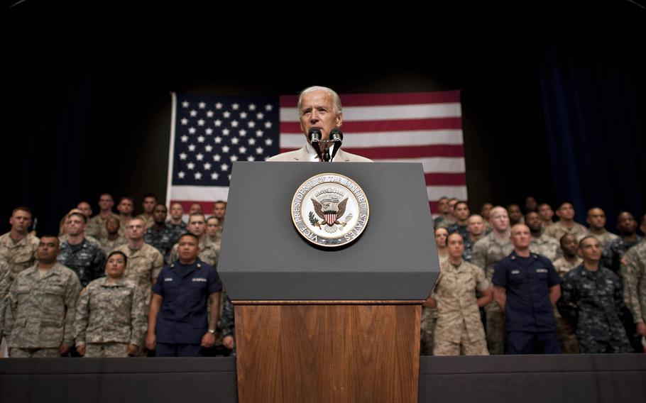 Then-Vice President Joe Biden speaks to military personnel inside the Taiyo Community Center at Yokota Air Base, Japan, Aug. 24, 2011.