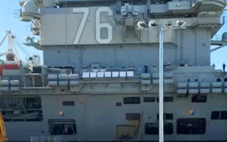 The aircraft carrier USS Ronald Reagan arrives at its homeport, Yokosuka Naval Base, Japan, in this screenshot from a live video on the carrier's Facebook page, Saturday, Nov. 14, 2020.