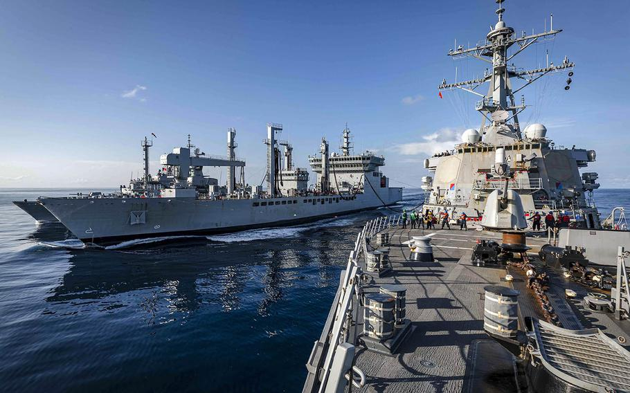 The guided-missile destroyer USS John S. McCain conducts a replenishment-at-sea with the Indian navy fleet tanker INS Shakti and the Royal Australian Navy frigate HMAS Ballarat during Malabar drills in the Indian Ocean, Nov. 4, 2020.