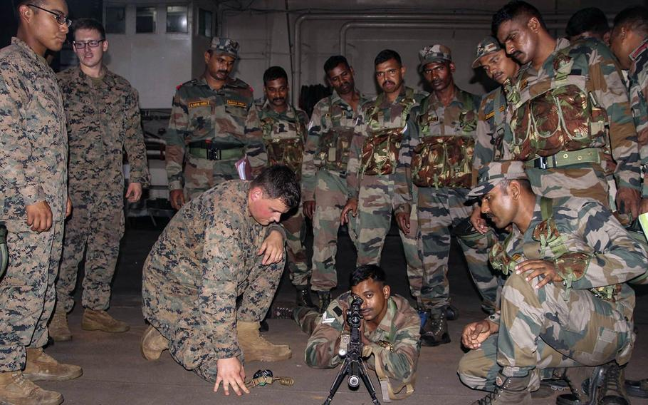 U.S. Marines and Indian soldiers educate one another about their respective weapon systems during exercise Tiger Triumph aboard the INS Jalashwa in India, Nov. 17, 2019.