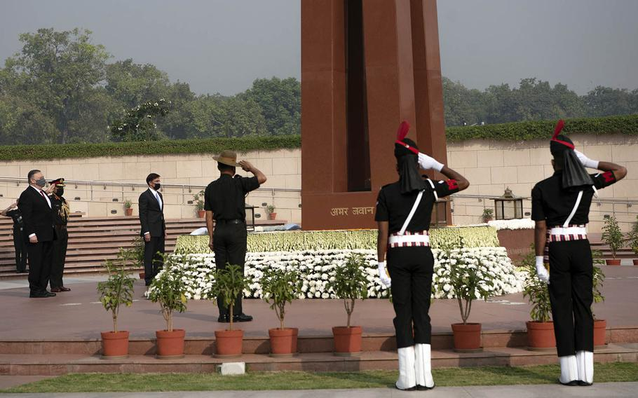 Secretary of State Mike Pompeo and then-Defense Secretary Mark Esper lay wreaths at the National War Memorial in New Delhi, India, Oct. 27, 2020.