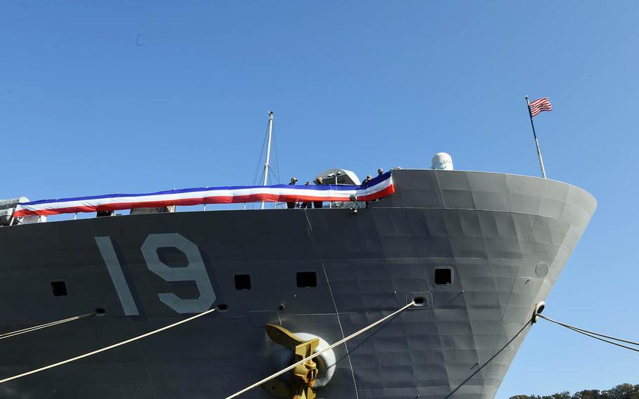 Sailors aboard the U.S. 7th Fleet flagship, USS Blue Ridge, decorate the ship at Yokosuka Naval Base, Japan,  Nov. 14, 2020, in preparation of its 50th anniversary.