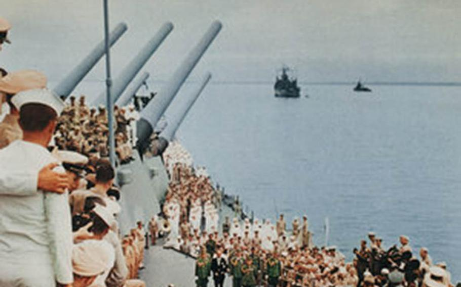 Spectators crowd the decks of the USS Missouri in Tokyo Bay on Sept. 2, 1945, as officials of Imperial Japan sign the formal surrender document that ended World War II.