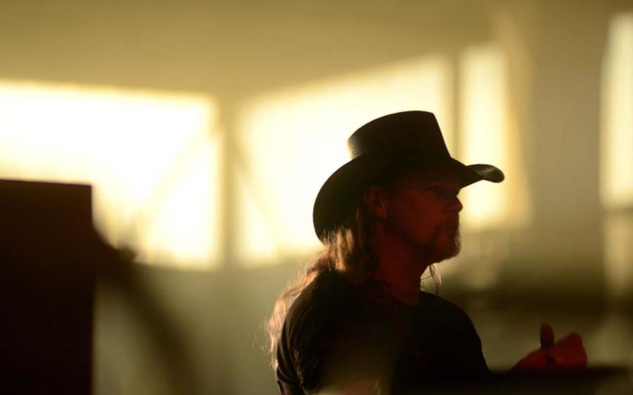 After heavy rain showers, the sun finally appeared Sept. 11, 2011, to shine through the windows of hangar 3 on Ramstein Air Base and light up Trace Adkins, just as Adkins lit up the hangar with his free concert to commemorate the 10th anniversary of 9/11.