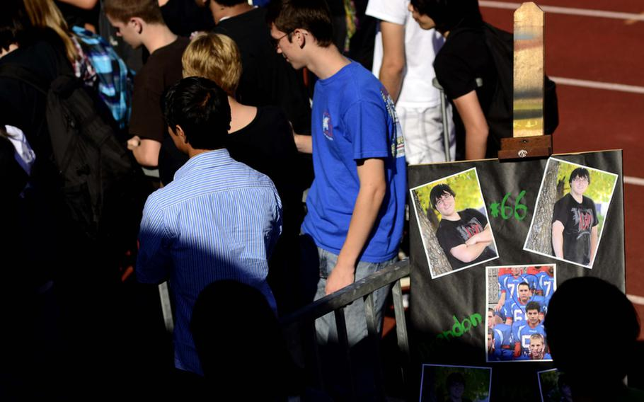 Ramstein High School students gather at the school's football field to remember Brendon Holtzen, the 17-year-old stepson of an American servicemember, who was killed Wednesday evening in a car crash near Ramstein.