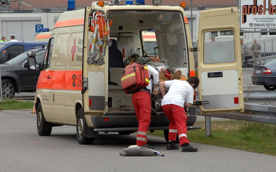 Paramedics with the Bayerisches Rotes Kreuz load a soldier into the back of an ambulance at the USAG Hohenfels clinic on Wednesday.