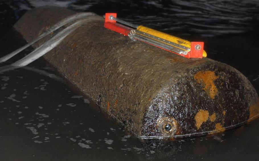 A defused HC-4000 bomb sits in the Rhine River in Koblenz, Germany, waiting to be transported on a cargo ship. The device strapped on top of the bomb was placed there identify it and help it float on top of the water. The nearly 4,000-pound World War II era bomb was deactivated Dec. 4, 2011.
