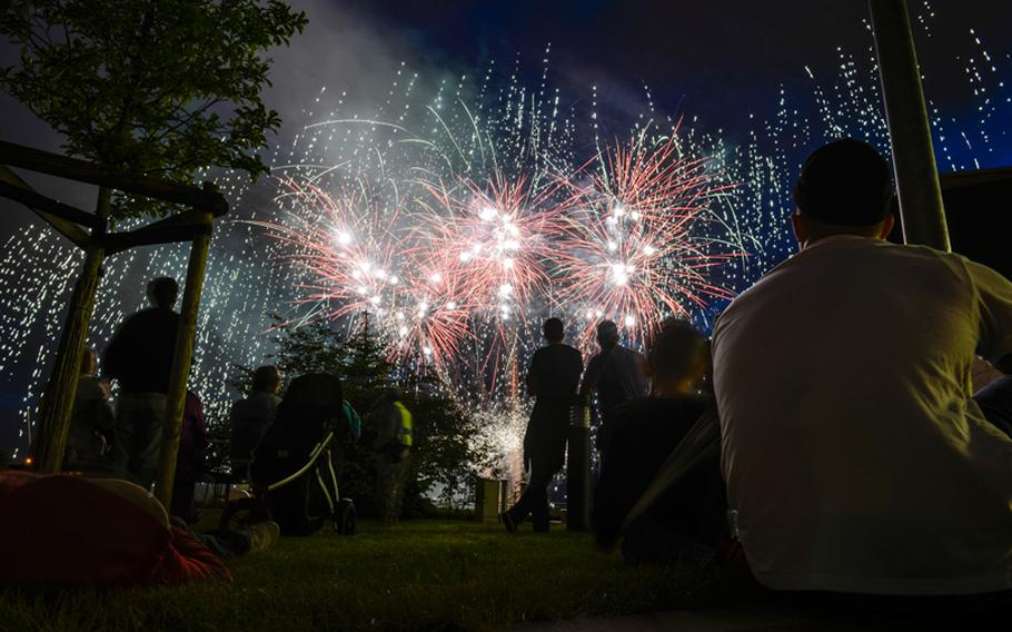 Attendees at the 2013 Independence Day celebration at Wiesbaden, Germany, watch fireworks July 3, 2013.