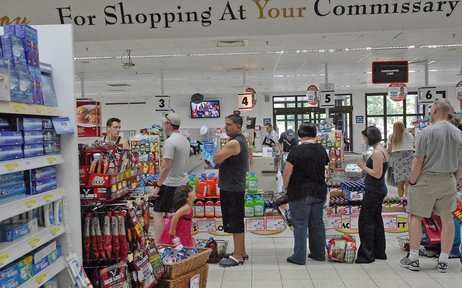 Shoppers set down their baskets of groceries while waiting to check out Monday evening at the Vogelweh Commissary. With the nearby Ramstein Commissary closed and staffing reduced at the Vogelweh store due to the first day of the Defense Department's civilian furlough, Vogelweh customers faced unusually long lines.