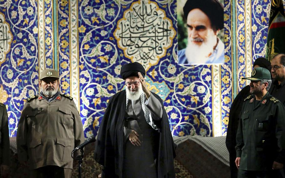 """In this photo released by an official website of the Iranian supreme leader's office on Wednesday, Nov. 20, 2013, Iran's Supreme Leader Ayatollah Ali Khamenei waves to members of the paramilitary Basij force at the Imam Khomeini Grand Mosque in Tehran, Iran. Khamenei says pressure from economic sanctions will never force the country into unwelcome concessions as nuclear negotiators resumed talks with world powers. Khamenei also blasted U.S. government policies, including threats of military action, but said Iran has """"no animosity'"""" toward the American people and seeks """"friendly"""" relations."""