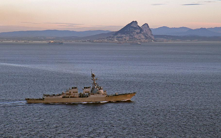 The USS Roosevelt, attached to the George H.W. Bush Carrier Strike Group, transits the Straits of Gibraltar near the Mediterranean Sea on Feb. 27, 2014.