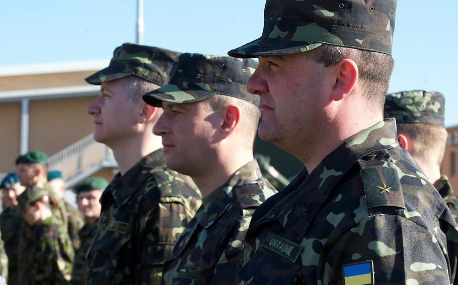 Ukrainian soldiers stand in formation at the opening ceremony for U.S. Army Europe's Saber Guardian exercise, Friday, March 21, 2014, at the Novo Selo Training Area, Bulgaria. Saber Guardian is a multinational military exercise involving about 700 military personnel from 12 nations as well as representatives from NATO.