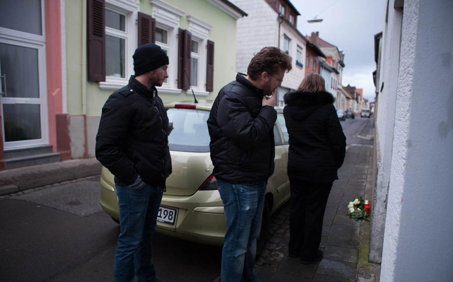 Andrey Chepusov, Dennis Bushmitch and Eugenia Bushmich, the brothers and mother of slain Petty Officer 2nd Class Dmitry Chepusov, stand outside of the apartment building in Kaiserslautern, Germany, on Jan. 30, 2015, where the sailor was killed. His American Forces Network colleague, Air Force Staff Sgt. Sean Oliver, was found guilty of his December 2013 murder and sentenced to life in prison.