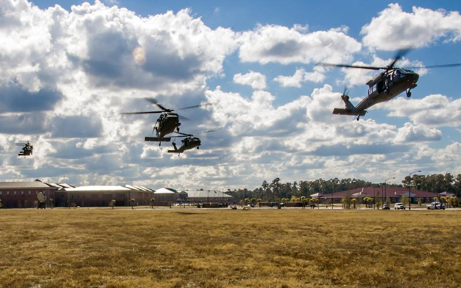 UH-60M Black Hawk helicopters from the 3rd Infantry Division begin to land in unison Dec. 1, 2014, at Fort Stewart, Ga. U.S. Army Europe announced on March 3, 2015,  that 450 soldiers and 25 Black Hawk helicopters from the unit will be deploying to Illesheim, Germany, later in March as part of Operation Atlantic Resolve.