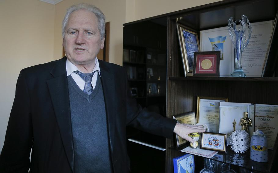 In this photo taken in Feb. 17, 2015, Volodymyr Kuzovkin, director of the jewelry factory talks with a reporter in his office in Lviv, Western Ukraine. Despite Ukraine's desperation to integrate with Europe, a desire so strong it sparked the protests that ousted pro-Russian President Viktor Yanukovych last year, much of Ukrainian business remains wedded to Soviet-era practices even as it is buffeted by a very modern economic crisis. Ukraine is hoping to improve links between its heavy industry and European markets to help the economy recover. But for companies like Kuzovkin's Lviv State Jewelry Factory in western Ukraine, the challenges are huge.