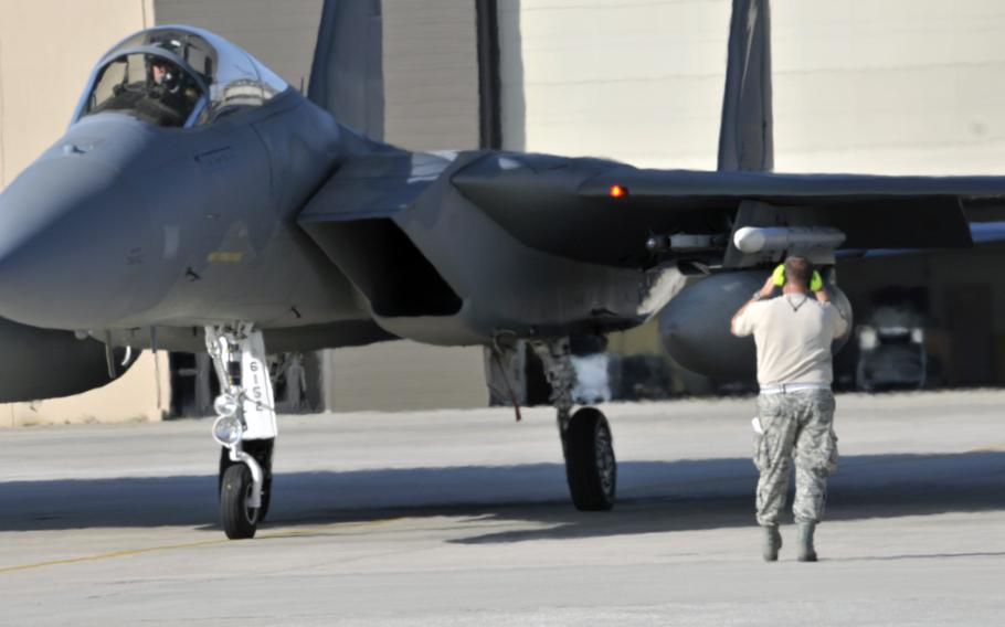 A Florida Air National Guard crew chief prepares to launch an F-15 for a routine training mission at the 125th Fighter Wing, Jacksonville, Fla., in August 2014. About 200 airmen and 12 aircraft from the wing are deploying soon to Europe in support of Operational Atlantic Resolve.