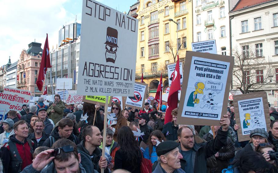 Protesters gathered at the foot of Prague's Wenceslas Square to express their opposition to tthe U.S. Army's planned convoy through the Czech Republic, Saturday, March 28, 2015.