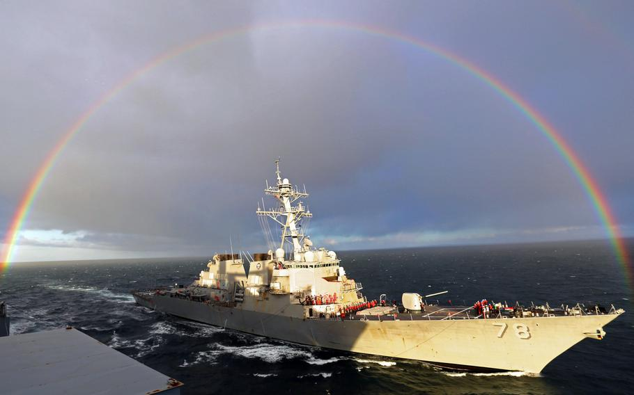 In this file photo from Wednesday, April 15, 2015, the guided-missile destroyer USS Porter pulls alongside the Military Sealift Command dry cargo and ammunition ship USNS Medgar Evers prior to a replenishment at sea.