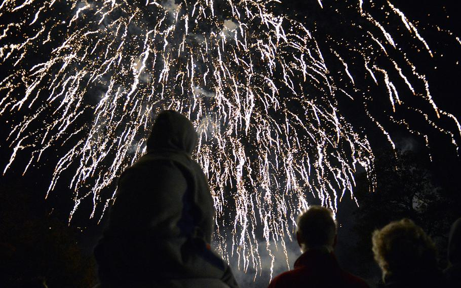 Community residents watch the grand finale of a fireworks display over Abbey Gardens in Bury St. Edmunds, England on Nov. 2, 2013, as U.S. airmen stationed at RAF Mildenhall provided security for the event.