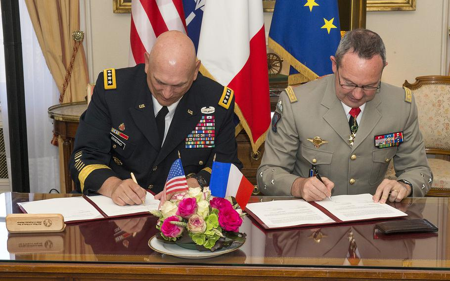 U.S. Army Chief of Staff, Gen. Ray Odierno (left), and France Army Chief of Staff, Gen. Jean-Pierre Bosser sign the French Strategic Vision Statement and Presser in the Hotel des Invalides, Paris, France, on July 10, 2015. Odierno was on a four-day tour of Europe where he visited Soldiers in training, U.S. Army Europe leadership, and dignitaries in four countries.
