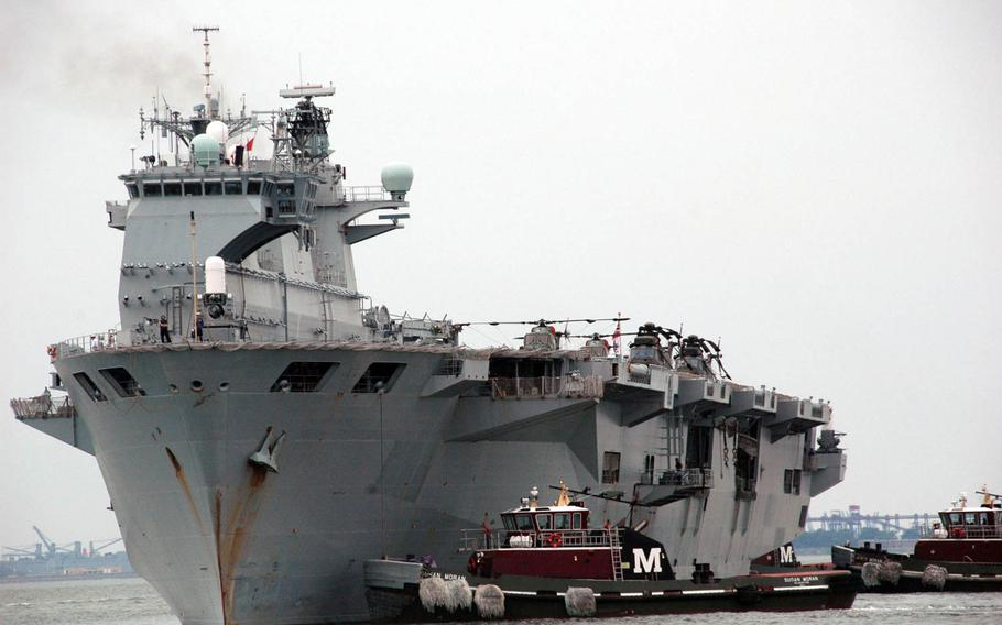 The British Royal Navy flagship HMS Ocean is pictured at Naval Station Norfolk, Va., during a 2010 deployment. U.S. Marines are looking at whether foreign ships such as the Ocean can be used as platforms for crisis-response units based around the MV-22 Osprey tilt-rotor aircraft.