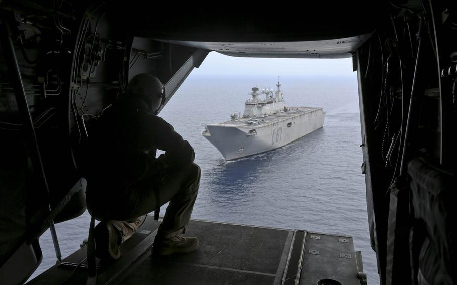 An MV-22 Osprey tilt-rotor aircraft departs the Spanish amphibious assault ship Juan Carlos I during a bilateral carrier qualification near Naval Station Rota, Spain, on June 18, 2014. The landing was the first for an Osprey aboard the warship, one of Spain's newest. The Marines are looking at whether foreign ships like Juan Carlos I can serve in a pinch as platforms for Osprey-based crisis-response units.