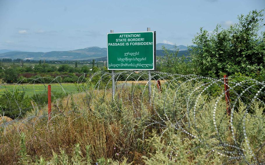 A section of the border between the breakaway enclave of South Ossetia and Georgia near Khurvaleti is well marked by signs and barbed wire. Another section nearby is not and was the scene of a tense standoff between Georgian police and armed, uniformed men who crossed over from South Ossetia, Thursday, July 16, 2015.