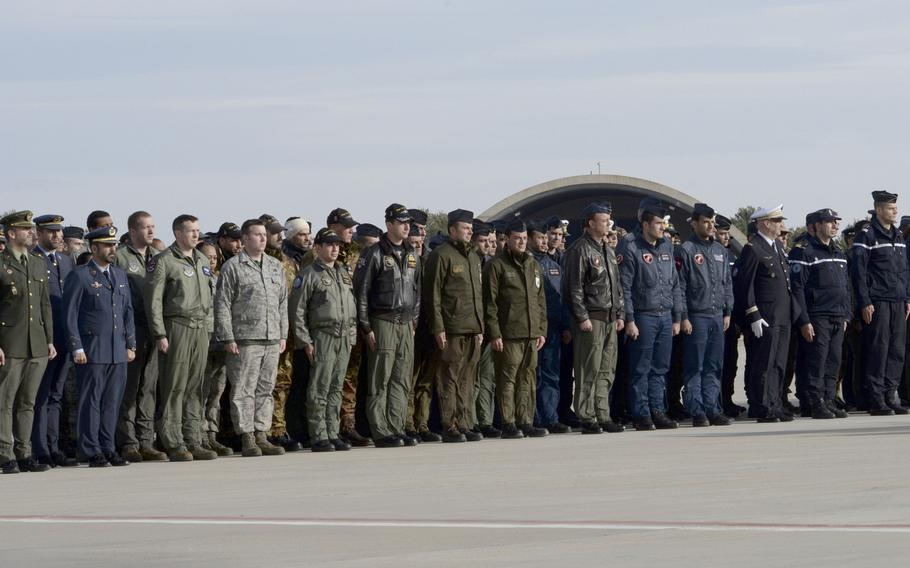 Airmen of the 48th Fighter Wing pay their respects alongside NATO allies at a memorial service honoring fallen members of the French Air Force at Los Llanos Air Base, Albacete, Spain, Jan. 29, 2015. Eleven airmen from the Greek and French air forces lost their lives after a Greek F-16 crashed during a NATO exercise. A safety investigation found that a loose checklist inside the cockpit was the likely cause of the crash.