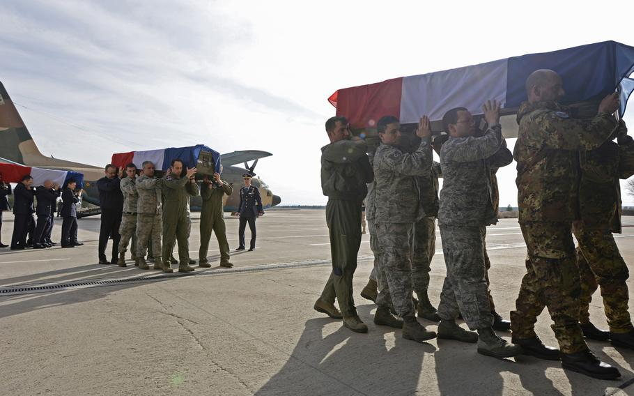 Airmen of the 48th Fighter Wing join with NATO allies to carry nine fallen members of the French air force during a memorial service at Los Llanos Air Base, Albacete, Spain, Jan. 29, 2015. Eleven airmen from the Greek and French air forces lost their lives when a Greek F-16 crashed during a NATO exercise. A safety investigation found that a loose checklist inside the cockpit was the likely cause of the accident.